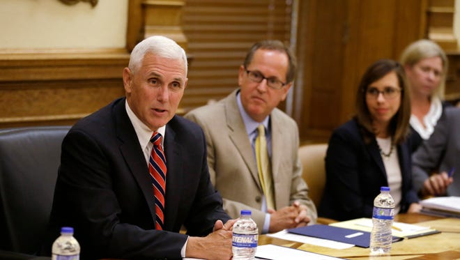 Republican vice presidential candidate, Indiana Gov. Mike Pence, holds a Cabinet meeting at the Statehouse in Indianapolis, Friday, July 29, 2016.