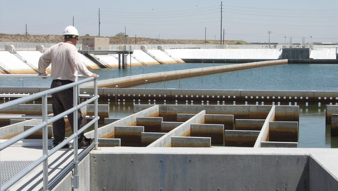 A Phoenix water services worker checks a filtration basin at the city's Union Hills Water Treatment Plant.