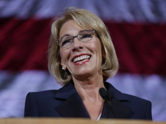 In this Oct. 13, 2017 file photo, U.S. Education Secretary Betsy DeVos speaks during a dinner hosted by the Washington Policy Center in Bellevue, Wash. The Associated Press has learned the Education Department is considering only partially forgiving federal loans for students defrauded by for-profit-colleges. That would mean abandoning the Obama administration's policy of fully erasing that debt.