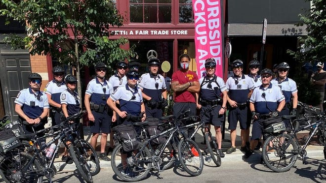 A June photo of former OSU star Chase Young posing with CPD officers in the Short North obtained via a public record request