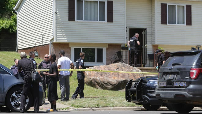 Akron police investigate a shooting on Manchester Road on Wednesday, June 17, 2020, in the Summit Lake neighborhood of Akron, Ohio.