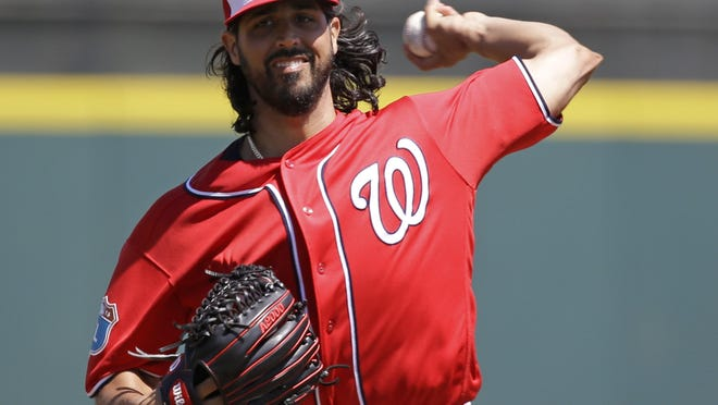 Washington Nationals starting pitcher Gio Gonzalez throws in the first inning of a spring training baseball game against the Houston Astros, Tuesday, March 15, 2016, in Kissimmee, Fla. (AP Photo/John Raoux)