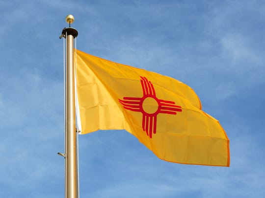 New Mexico - In a common theme relating to state flags, the Daughters of the American Revolution encouraged the modern design of the New Mexico flag. It has a red sun symbol on a background of bright yellow. It is one of only four states to not have the color blue in its design. (Other states are California, Alabama, and Maryland).