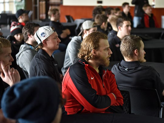 St. Cloud State players watch the NCAA hockey tournament
