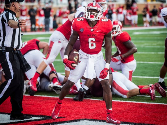 Ball State's Teddy Williamson celebrates after scoring a touchdown against Eastern Kentucky during their game at Scheumann Stadium Saturday, Sept. 17, 2016.