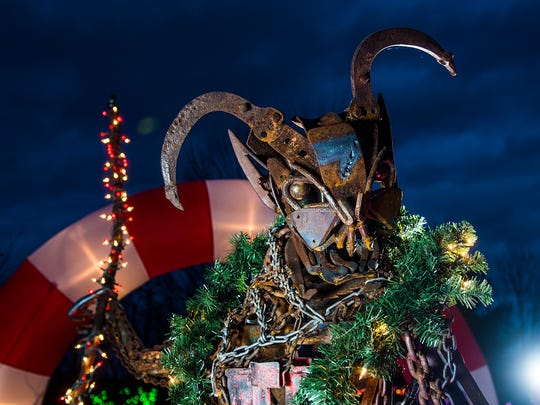 Jeff Asper, artist, metal sculptor and owner of Tossed and Found Art, displays his newest piece of work at his New Oxford home  - a sculpture of Krampus.