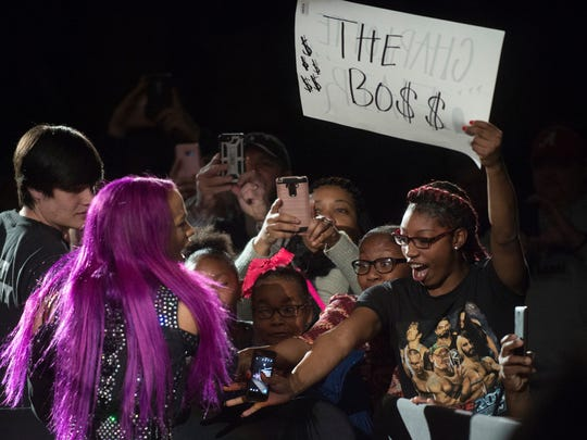 Sasha Banks greets fans during the WWE Raw Live performance at the Garrett Coliseum in Montgomery, Ala., on Saturday, Jan. 7, 2017.