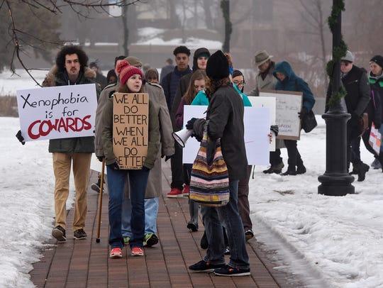 Protestors gather to begin a walk Friday, Jan. 20,