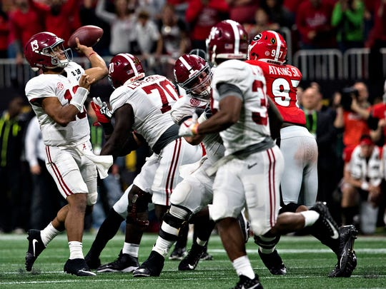 Alabama quarterback Tua Tagovailoa (13) throws game winning touchdown in overtime to Alabama wide receiver DeVonta Smith (6) during the NCAA National Championship football game between Alabama and Georgia on Monday, Jan. 8, 2018, in Atlanta, Ga.