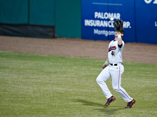 Auburn's Steven Williams catches a fly ball during the Capitol City Classic between Alabama and Auburn on March 27 at Riverwalk Stadium.