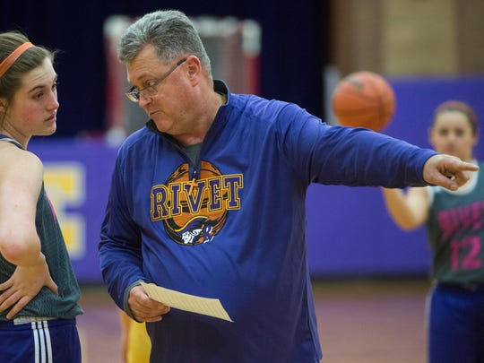Rivet girls basketball coach Rick Marshall talks with freshman center Lauren Carie during a practice at Vincennes Rivet High School on Thursday, Feb. 22, 2018.