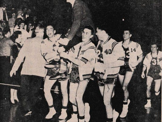 Players Carry Coach Fred Driver