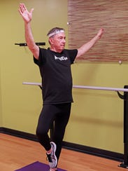 Jack Lofte, demonstrates the mountain pose as part