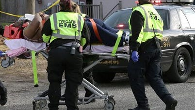 Emergency personnel take shooting victim, rapper Beanie Sigel, from a house on Spruce Avenue in Plesantville, N.J. on Dec. 5, where he and another man were wounded. Sigel, whose real name is Dwight Grant, was in surgery and listed in critical condition, according to his attorney.