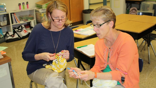 Debbie Schroeder and Donna Lohr help crochet hats and other accessories for My Sister's Gifts, a Crochet for Cancer chapter in Florence.