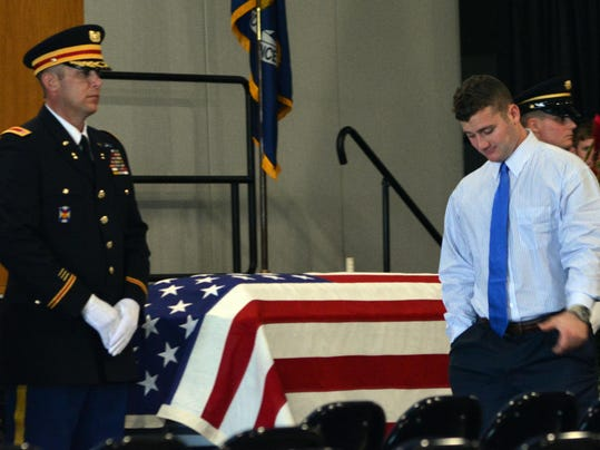 ANI Strother Wake D.J. Strother, son of the late National Guardsman CW4 David Strother, walks past his father's casket at a visitation held Wednesday, March 25, 2015 at the Alexandria Riverfront Center.-Melinda Martinez/mmartinez@thetowntalk.com
