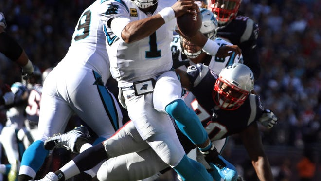 Panthers quarterback Cam Newton scrambles away from pressure during a game against the Patriots on Oct. 1, 2017 at Gillette Stadium.