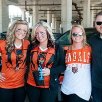 Fans tailgate before the Bengals - Seahawks game. Samantha Keseday, Candice Fischer, Allison and Phillip Young.