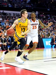 UMBC Retrievers forward Joe Sherburne (13) drives to the basket against Virginia Cavaliers forward Mamadi Diakite during a first round game on March 16, 2018, at the Spectrum Center in Charlotte, North Carolina. Sherburne and the Retrievers became the first-ever team seeded 16 to defeat a No. 1 seed in the NCAA Tournament.