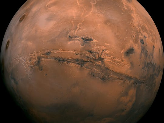 FILE - This image made available by NASA shows the planet Mars. This composite photo was created from over 100 images of Mars taken by Viking Orbiters in the 1970s. In our solar system family, Mars is Earth's next-of-kin, the next-door relative that has captivated humans for millennia. The attraction is sure to grow on Monday, Nov. 26 with the arrival of a NASA lander named InSight. (NASA via AP, File)