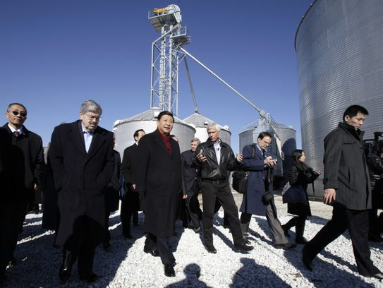 China's then-Vice President Xi Jinping, center, is