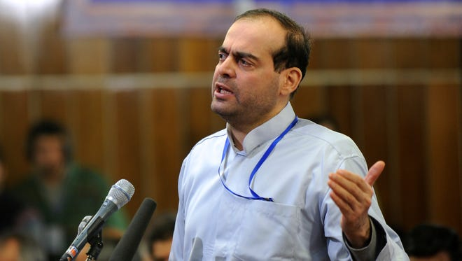 In this picture Feb. 18, 2012, photo, released by the Iranian Students News Agency, ISNA, Mahafarid Amir Khosravi speaks at his trial in a court in Tehran, Iran.