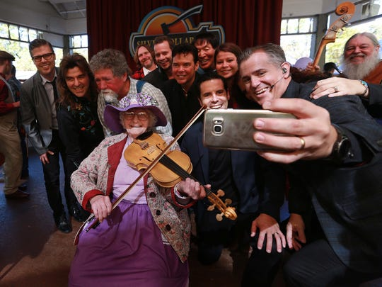 Violet Hensley celebrated her 100th birthday at Silver Dollar City, where she has demonstrated her fiddle making craft for 50 years. She was born on Oct. 21, 1916. No Branson celebration would be complete without a selfie taken with performers The Duttons and The Haygoods.