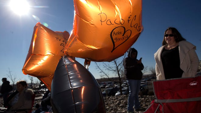 "Community members wait for the funeral procession for Francisco ""Paco"" Fernandez on Piñon Hills Boulevard on Friday in Farmington."