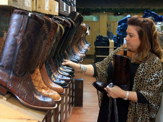 GABE HERNANDEZ/CALLER-TIMESCarrie Doreck arranges boots for Small Business Saturday, on Tuesday, Nov. 22, 2016, at Boots n Britches in Corpus Christi.