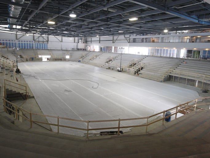 A look inside at the rink surface and 4,300 seating bowl surrounding it in RIT's new hockey rink, the Gene Polisseni Center, on June 11, 2014.