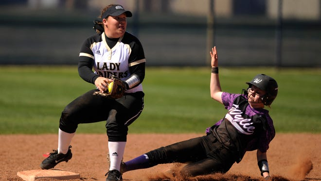 Wichita Falls Rider second baseman Jaida Vinson (7) forces out Wylie's Carrie Clark (2) during the bottom of the second inning of the Lady Bulldogs' 13-3 win over Wichita Falls Rider in the Abilene Ice Breaker Tournament on Saturday, Feb. 25, 2017, at Cooper High School.
