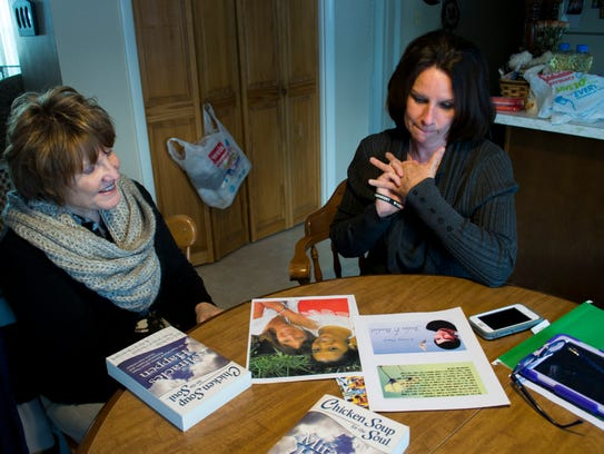 Lisa Benkert sits with Dwendy Johnson and shares stories