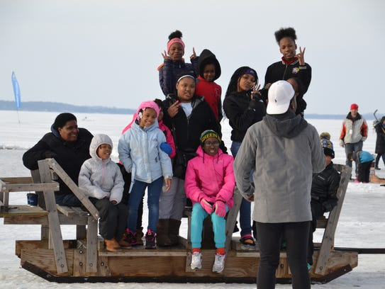 Kids pose for a photo on Lake Mendota during the Frozen