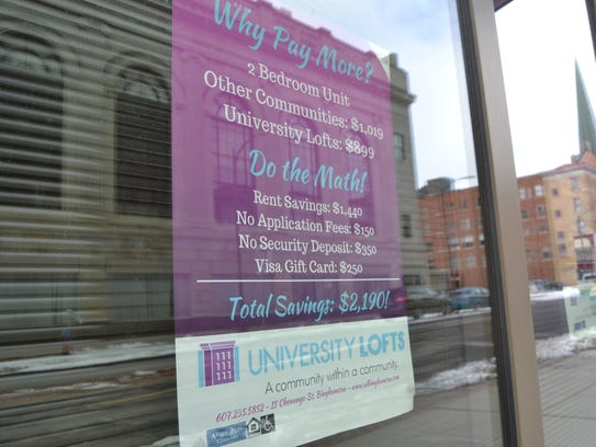 A sign in University Lofts' window advertises promotions