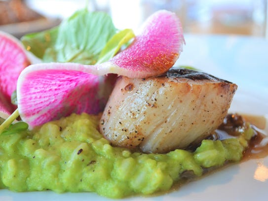 Scallops with pea risotto is served at Clearwater.