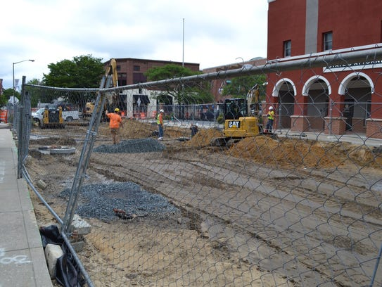 A crew works on the Main Street project between Route
