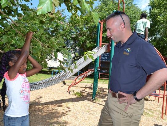 Salisbury Mayor Jake Day chats with Natiya Covington
