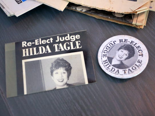 These pins are from U.S. District Judge Hilda Tagle