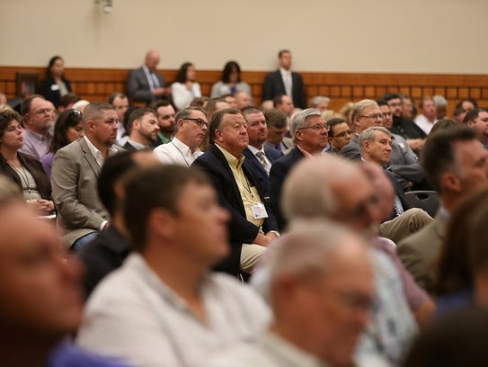A crowd attends a listening session on the 2018 Farm