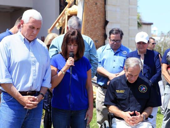 Vice President Mike Pence  listens as Karen Pence prays