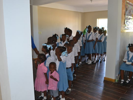 School children of the Ecole Notre Dame Du Perpetual