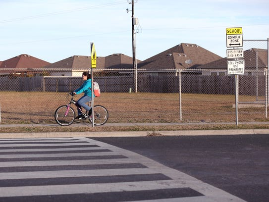 A Grant Middle School student rides her bike to school