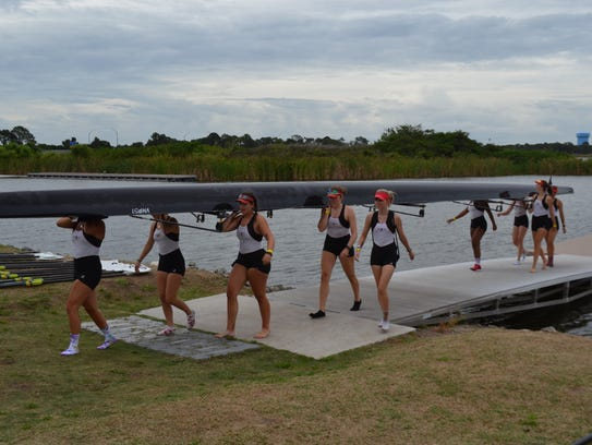 Rowers from CCR's women's varsity 8 boat come off the