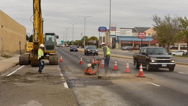 Crews deal with a broken water main on Second Street South in St. Cloud on Wednesday, Oct. 11.