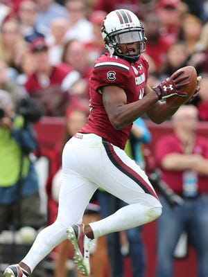 Nov 21, 2015; Columbia, SC, USA; South Carolina Gamecocks wide receiver Pharoh Cooper (11) looks back as he makes a catch during the game between the Bulldogs and the Gamecocks at Williams-Brice Stadium. Citadel upsets South Carolina 23-22. Mandatory Credit: Jim Dedmon-USA TODAY Sports