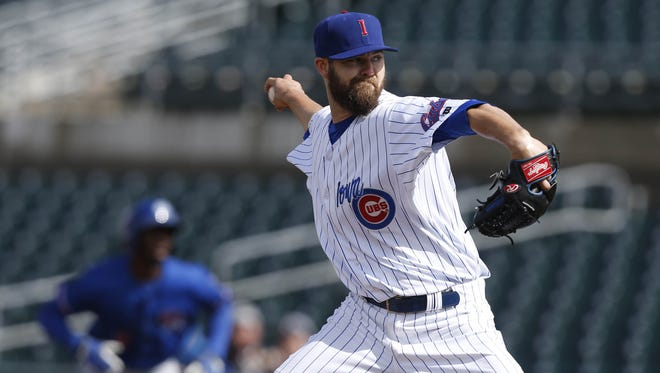 Iowa Cubs pitcher Ryan Williams throws against Round Rock Thursday, April 7, 2016, during their season opener at Principal Park in Des Moines.