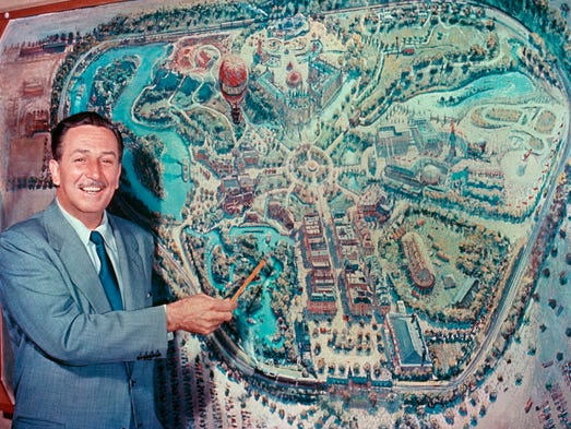 In front of an early rendering by Disney legend Peter