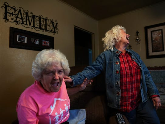 Patricia Shipman, 72, left, has a laugh with fellow