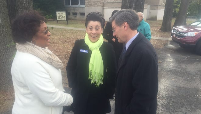 Metro Council members Cheri Bryant Hamilton, left, and Bill Hollander, right, talk about trees with incoming council member Barbara Sexton Smith, following a news conference Monday.
