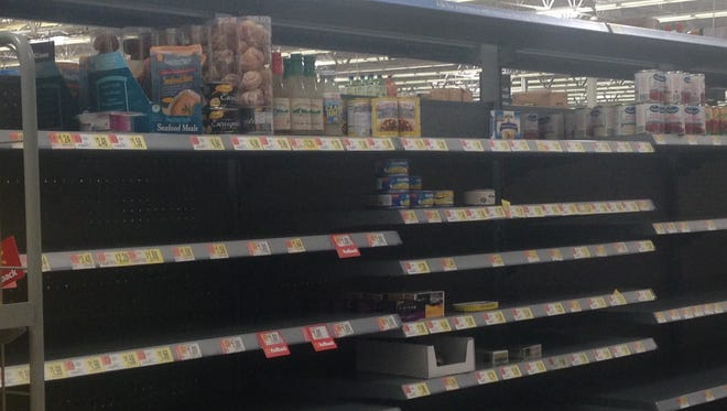 Little more than oysters, clams and escargot were left on the shelves in the canned meat aisle at the Fort Myers Walmart Supercenter on Colonial Boulevard.